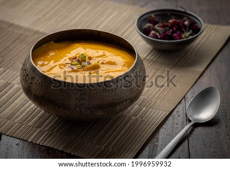 Mango Pulp or Aam rus or Aamras served in a metal bowls, famous Indian seasonal dessert Stok fotoğraf ©