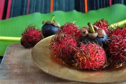 mangosteen and rambutan exotic fruits put on golden plate