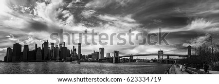 Manhattan and Brooklyn bridge over East river in panorama black and white, New York #623334719