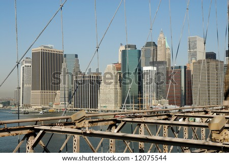 Manhattan as seen from the Brooklyn Bridge, suspension cables in the foreground