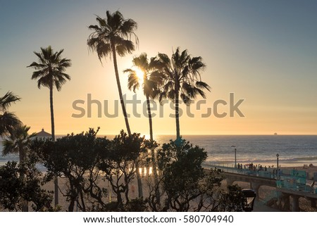 Manhattan Beach at sunset time in Southern California in Los Angeles. #580704940