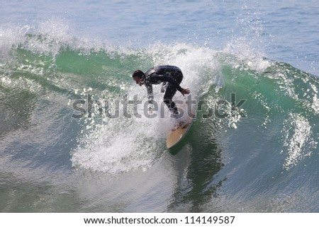 MANHATTAN BEACH, CALIFORNIA, USA - SEPTEMBER 28:Surfers enjoy large waves on September 28, 2012.  Large waves are caused by the 13th named Pacific Tropical Storm - Miriam to the south.