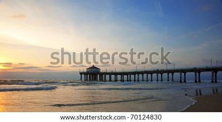 Manhattan Beach Pier under a scenic sunset - Los Angeles, California.