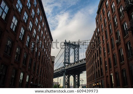 Manhattan Bridge and Brick Buildings in Brooklyn, New York, USA #609439973