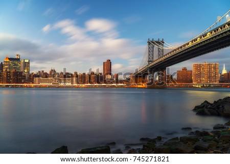 Manhattan bridge and Manhattan after sunset, New York City #745271821