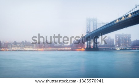 Manhattan bridge and Manhattan at foggy evening, New York City #1365570941