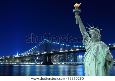 Manhattan Bridge and The Statue of Liberty at Night Lights, New York City