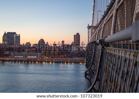 Manhattan Bridge at Sunset in New York City with City Skyline - U.S.A.
