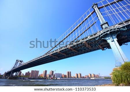 Manhattan Bridge over East River with skyline, New York City