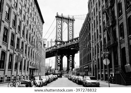Manhattan bridge seen from a brick buildings in Brooklyn street in perspective, New York, USA. Business and travel background. Vintage, retro postcard. #397278832
