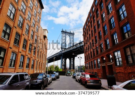 stock photo manhattan bridge seen from a red brick buildings in brooklyn street in perspective new york usa 374739577 - Каталог - 3d фотообои