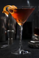 Manhattan cocktail with an orange twist as a garnish