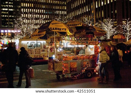 MANHATTAN - DECEMBER 4: A New York city street vendor get into the holiday spirit with lights on his cart on December 7, 2009 in New York City.