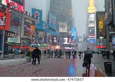 MANHATTAN - FEBRUARY 25: Commuters and tourists in Times Square during the latest snowstorm on February 25, 2010 in New York City.