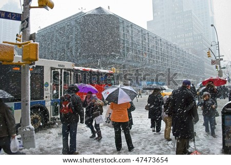 MANHATTAN - FEBRUARY 25: People on their commute home near the Port Authority during the latest snowstorm on February 25, 2010 in New York City.