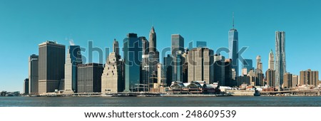 Manhattan financial district with skyscrapers over East River. #248609539