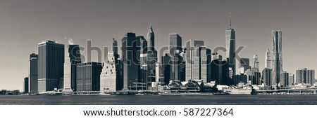 Manhattan financial district with skyscrapers over East River. #587227364