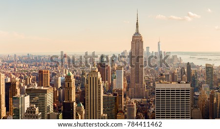 Manhattan Midtown Skyline with illuminated skyscrapers at sunset. NYC, USA #784411462