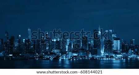 Manhattan midtown skyscrapers and New York City skyline at night panorama #608144021