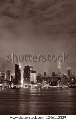 Manhattan midtown skyscrapers and New York City skyline at night with fog #1246112329