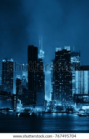 Manhattan midtown skyscrapers and New York City skyline at night with fog #767495704