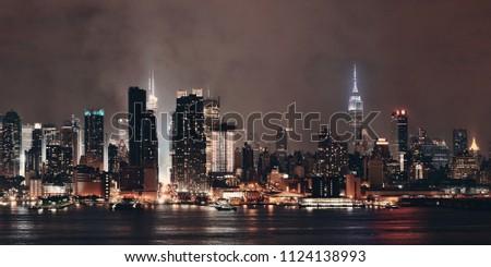 Manhattan midtown skyscrapers and New York City skyline panorama at night with fog #1124138993