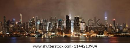Manhattan midtown skyscrapers and New York City skyline panorama at night with fog #1144213904