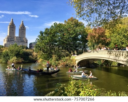 Manhattan, New York, October 22, 2017: people on boats and Bow bridge at Central Park in autumn - Shutterstock ID 757007266