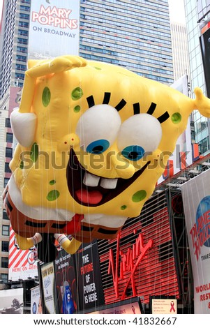 MANHATTAN - NOVEMBER 26 : A Sponge Bob balloon passing Times Square at the Macy's Thanksgiving Day Parade November 26, 2009 in Manhattan.