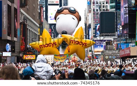 MANHATTAN - NOVEMBER 25 : cartoon character balloon passing Times Square at the Macy's Thanksgiving Day Parade November 25, 2010 in Manhattan.