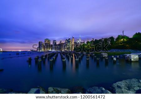 Manhattan panoramic skyline at night from Brooklyn Bridge Park. New York City, USA. Office buildings and skyscrapers at Lower Manhattan (Downtown Manhattan). #1200561472