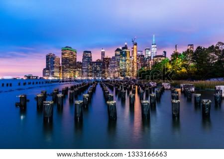 Manhattan panoramic skyline at night from Brooklyn Bridge Park. New York City, USA. Office buildings and skyscrapers at Lower Manhattan (Downtown Manhattan). #1333166663
