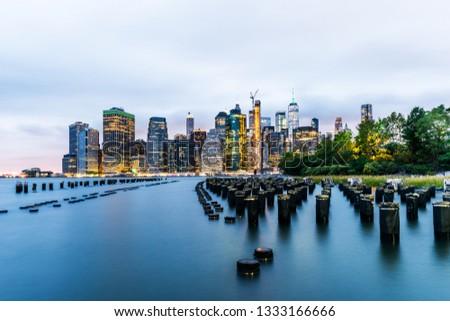 Manhattan panoramic skyline at night from Brooklyn Bridge Park. New York City, USA. Office buildings and skyscrapers at Lower Manhattan (Downtown Manhattan). #1333166666