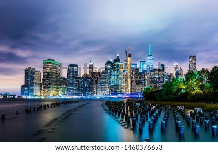 Manhattan panoramic skyline at night from Brooklyn Bridge Park. New York City, USA. Office buildings and skyscrapers at Lower Manhattan (Downtown Manhattan).