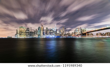 Manhattan panoramic skyline at night with Brooklyn Bridge. New York City, USA. Office buildings and skyscrapers at Lower Manhattan (Downtown Manhattan). #1195989340