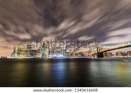 Manhattan panoramic skyline at night with Brooklyn Bridge. New York City, USA. Office buildings and skyscrapers at Lower Manhattan (Downtown Manhattan). #1340616608