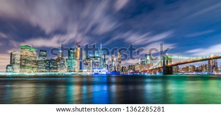 Manhattan panoramic skyline at night with Brooklyn Bridge. New York City, USA. Office buildings and skyscrapers at Lower Manhattan (Downtown Manhattan).   #1362285281