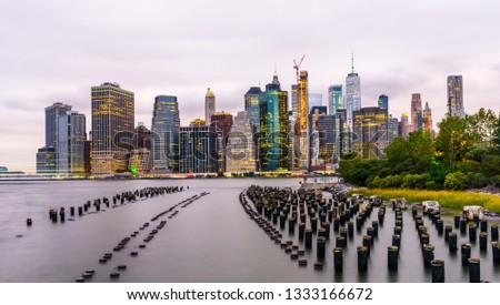 Manhattan panoramic skyline at sunset from Brooklyn Bridge Park. New York City, USA. Office buildings and skyscrapers at Lower Manhattan (Downtown Manhattan). #1333166672
