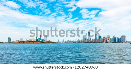 Manhattan panoramic skyline. New York City, USA. Office buildings and skyscrapers at Lower Manhattan (Downtown Manhattan). #1202740960