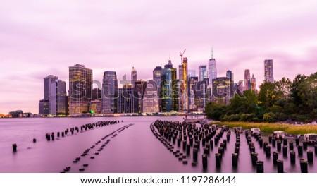 Manhattan panoramic skyline sunset view. New York City, USA. Office buildings and skyscrapers at Lower Manhattan (Downtown Manhattan). #1197286444