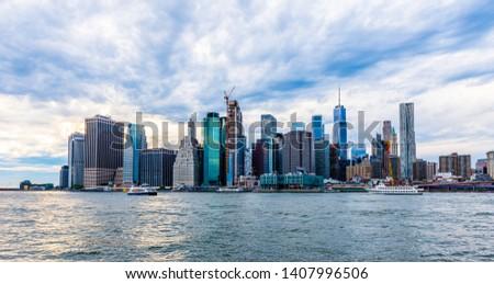 Manhattan panoramic skyline sunset view. New York City, USA. Office buildings and skyscrapers at Lower Manhattan (Downtown Manhattan). #1407996506
