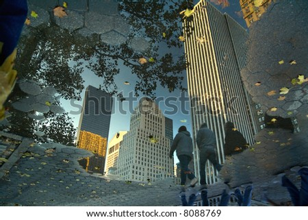 Manhattan, reflected in the puddle and inverted.