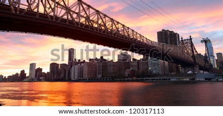 Manhattan skyline and Queensboro Bridge over East River at sunset, New York City