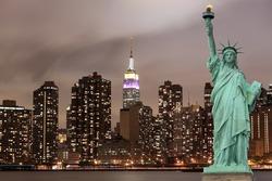 Manhattan Skyline and The Statue of Liberty at Night Lights, New York City