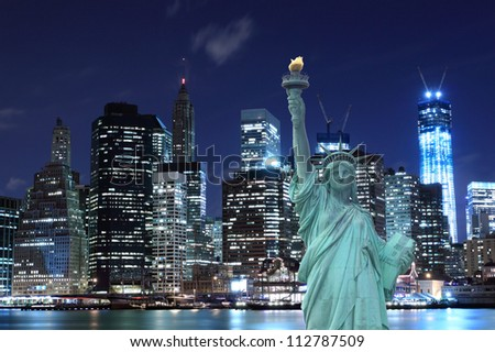Manhattan Skyline and The Statue of Liberty at Night, New York City #112787509