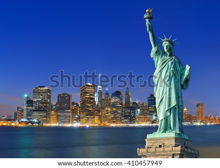 Shutterstock Manhattan skyline at night and Statue of Liberty.