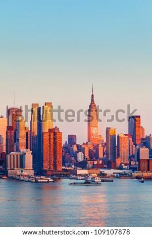 Manhattan Skyline illuminated by sunset