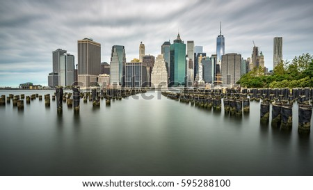 Manhattan skyline on a cloudy day #595288100