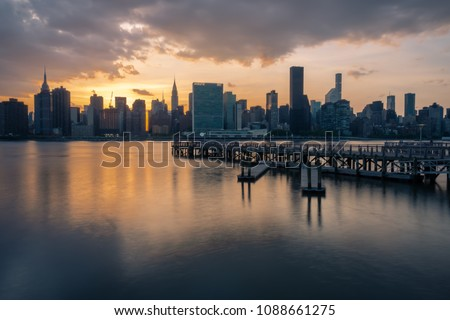 Manhattan skyline with Gantry Plaza State Park pier at sunset in Long Island City, Queens, NY #1088661275