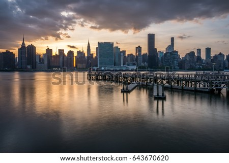 Manhattan skyline with Gantry Plaza State Park pier at sunset in Long Island City, Queens, NY #643670620